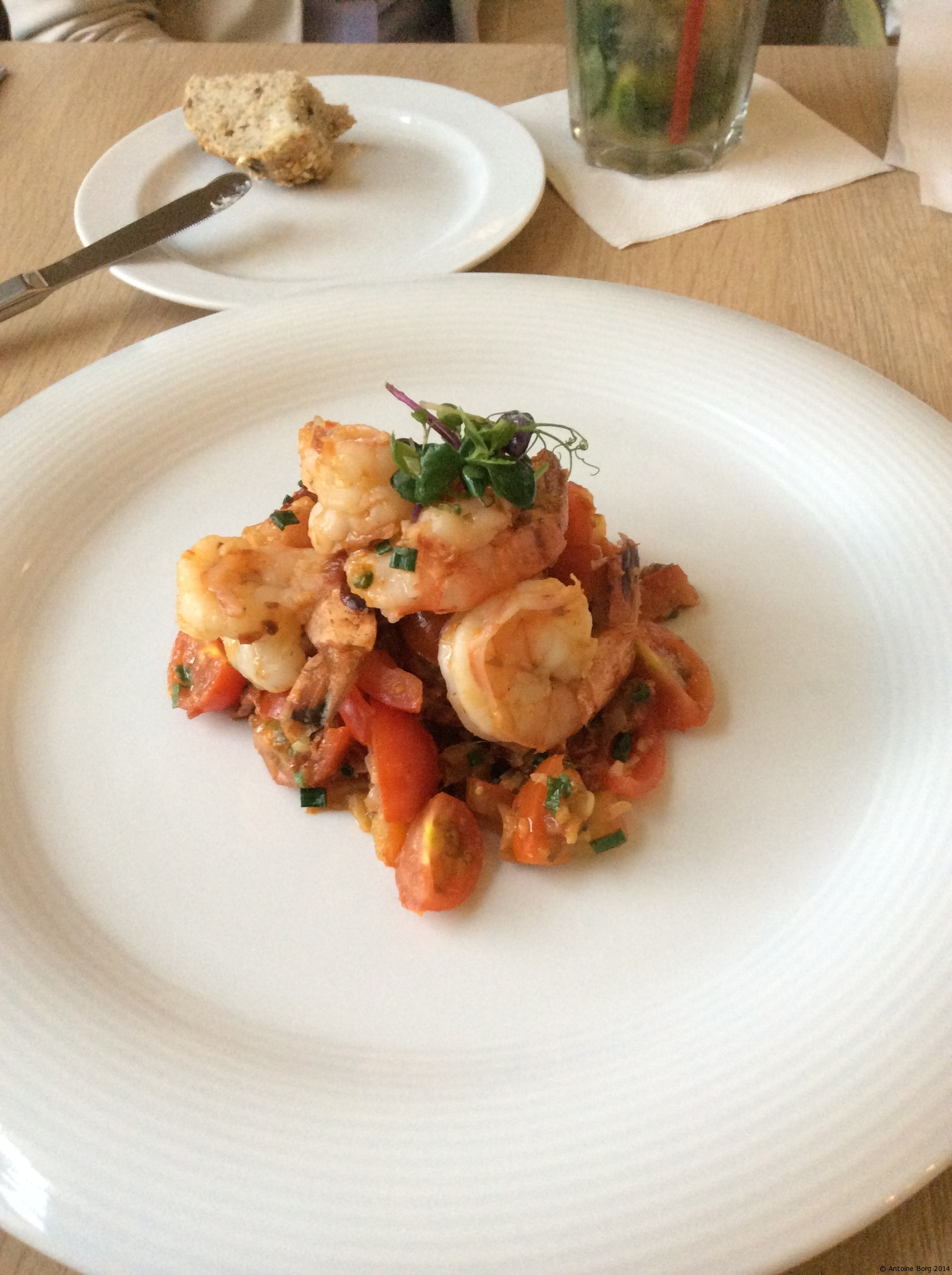 Shrimp on a bed of tomato salsa, sliced cherry tomatoes and sun-dried tomatoes