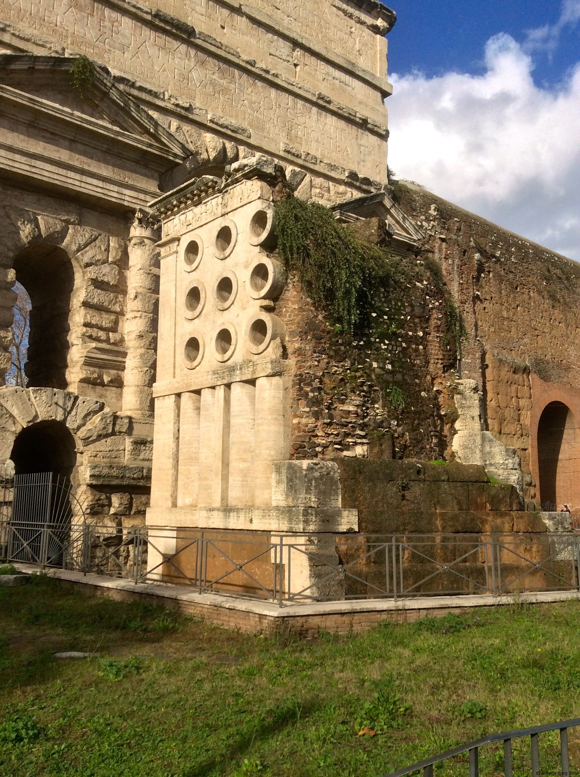 A photo of the baker's monument beside the walls of Ancient Rome