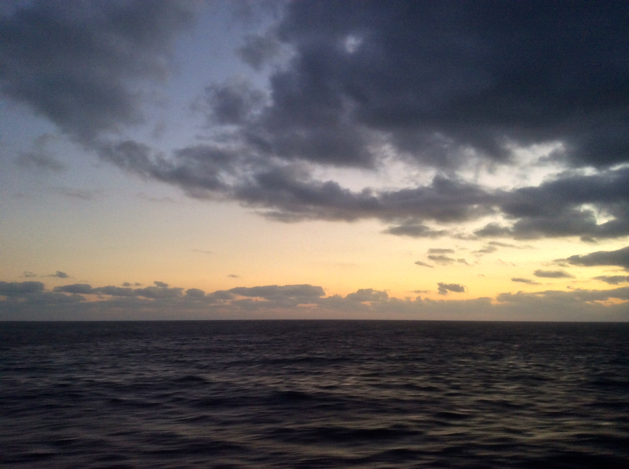 A photo of the sun rising over the Mediterranean